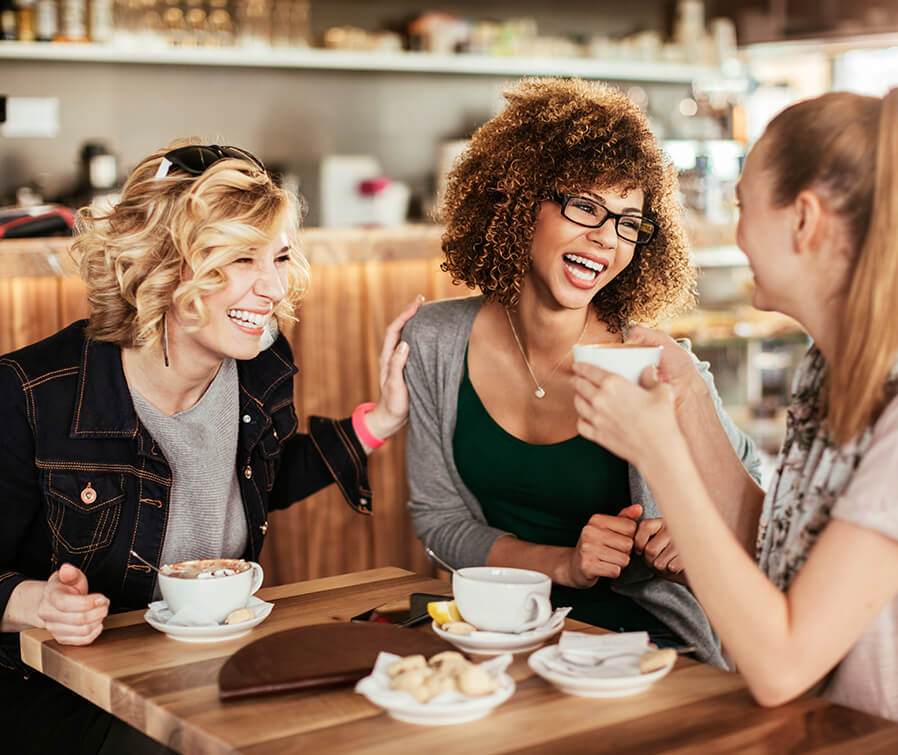 women having coffee laughing